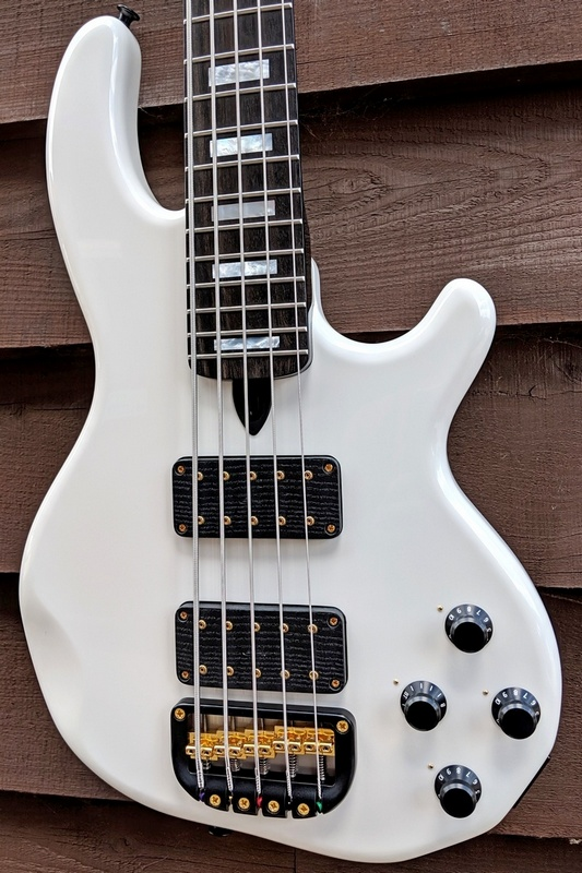 5-string Mk3 with gloss white finish, a fretted ebony fingerboard, MOP block inlays and gold hardware.