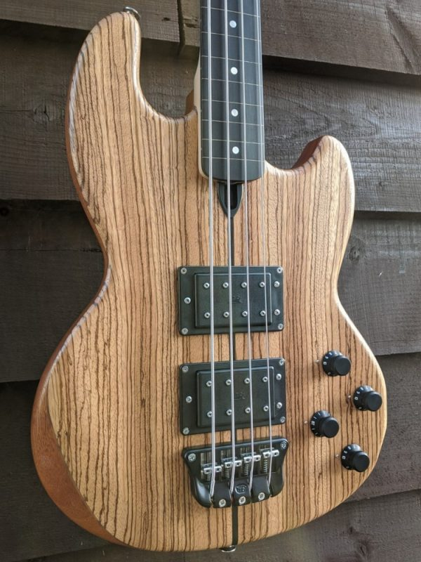 Mk1 with straight grained zebrano facings (with an ebony centre stripe) and a lined fretless ebony fingerboard.