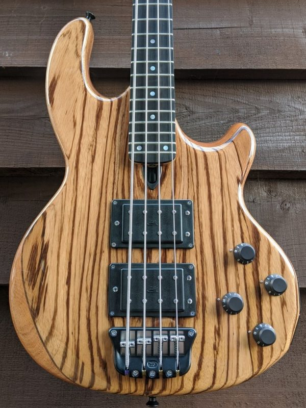 Mk2 with zebrano facings, a clear gloss body finish and a fretted ebony fingerboard.