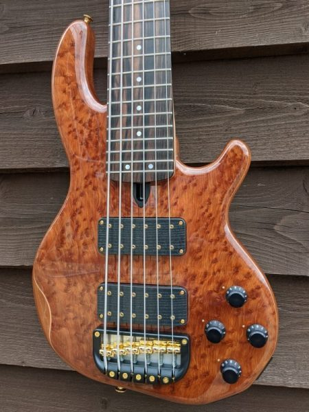 6-string Mk3 with burl redwood facings, a clear gloss body finish, Macassar ebony fingerboard and gold hardware.