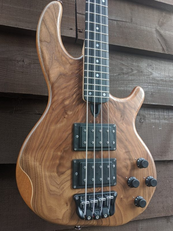 Mk3 with American walnut facings and a fretted ebony fingerboard.