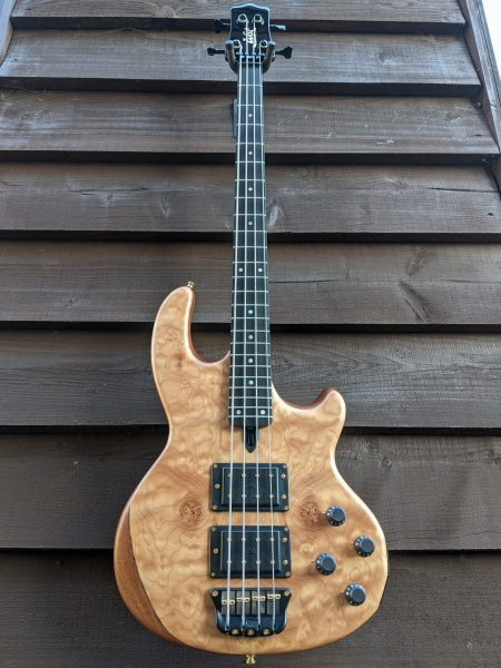 Mk2 with quilt maple facings, ebony fingerboard and gold hardware.
